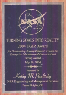 "Kathy Paultizky, Office Manager, was given the award for ""Turning Goals Into Reality"" for her contribution to Enterprise Education and Outreach Goal from NASA Glenn Research Center."